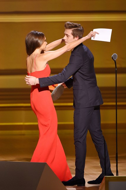 Brooklyn Beckham presented Victoria with the Fashion Force trophy at the 2015 Glamour Women of the Year Awards.