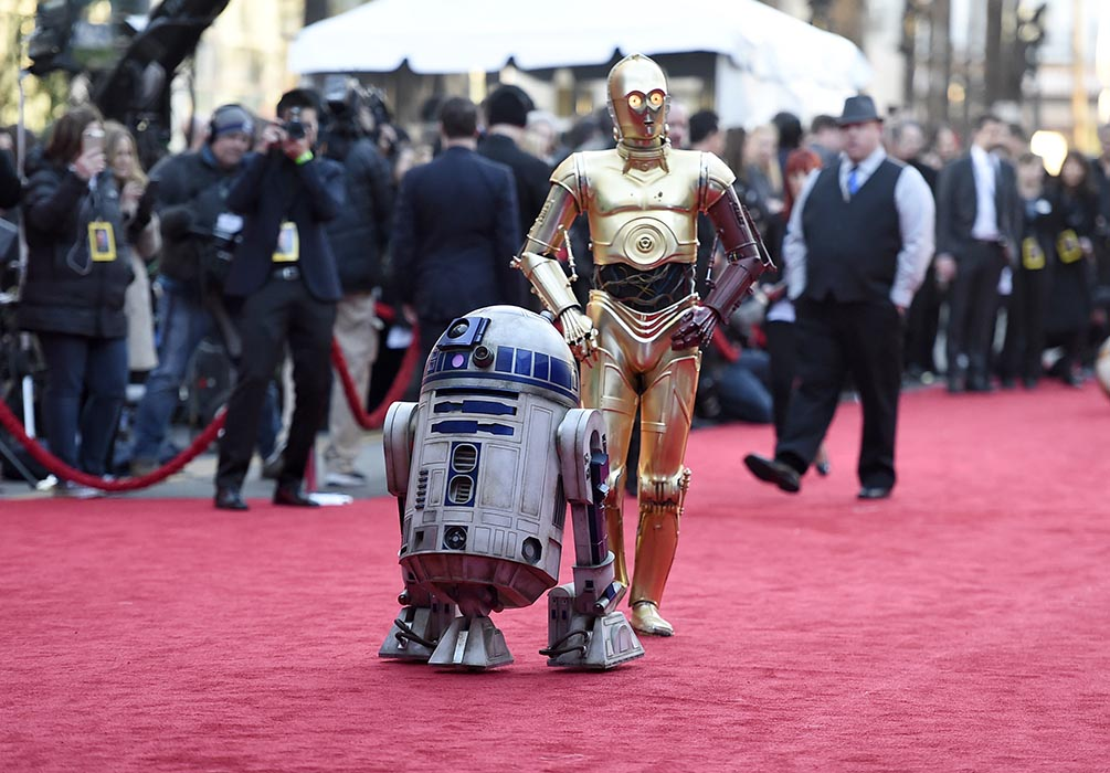 C3PO and R2-D2 arriving on the red carpet at the Los Angeles world premiere of Star Wars: The Force Awakens.