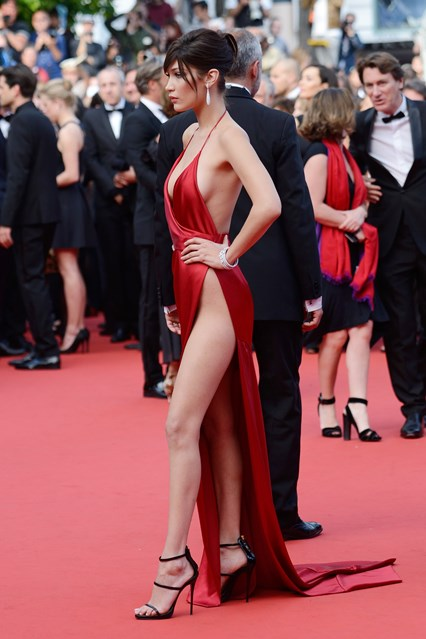 Bella Hadid poses in her jaw dropping Alexandra Vaulthier long slit dress, at the amfAR's annual Cinema Against AIDS gala at the Cannes Film Festival.