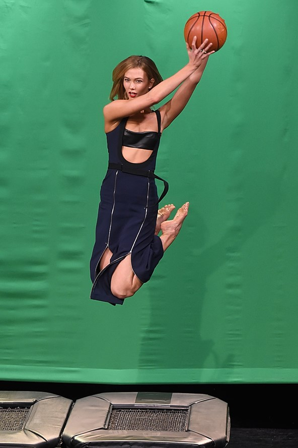 Karlie Kloss demonstrates her modelling talents during an appearance on The Tonight Show Starring Jimmy Fallon, teaching the talk show host to pose mid-air.