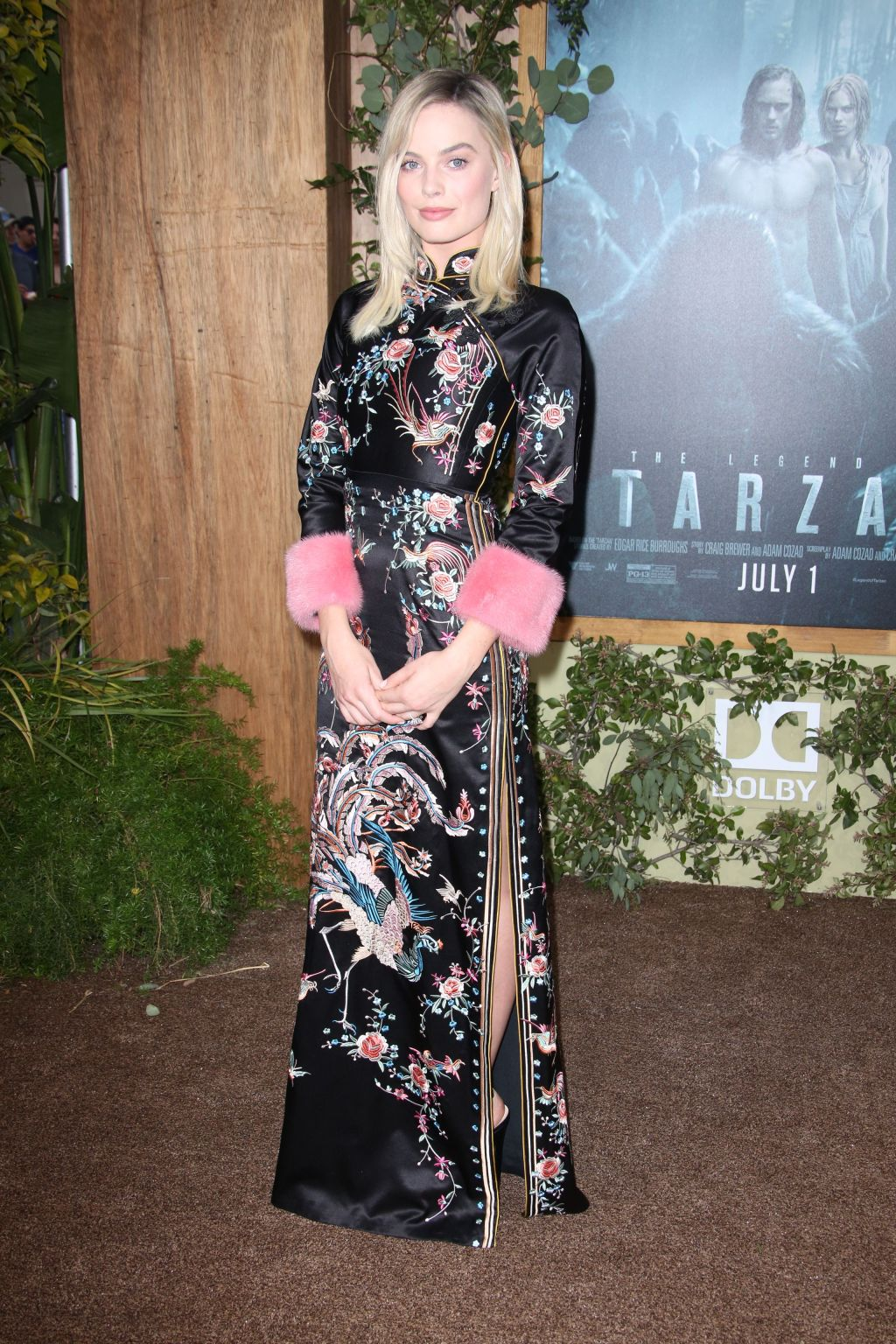 Margot Robbie, who plays Jane, wore a black silk kimono by Gucci for the Los Angeles premiere of The Legend of Tarzan.