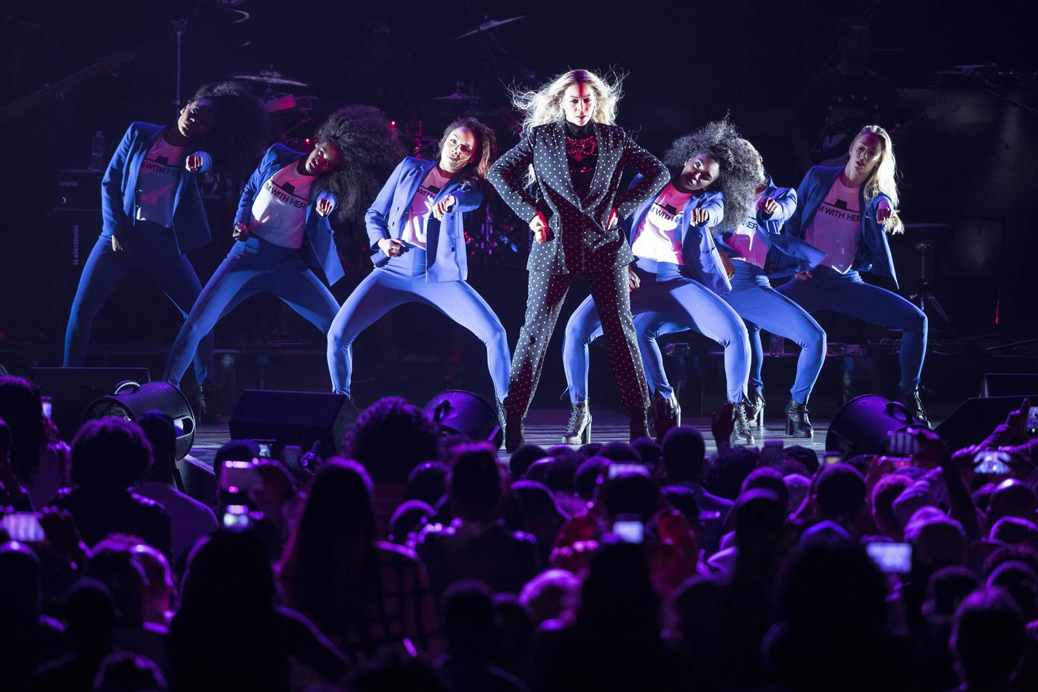 Beyoncé performed at a Get Out the Vote concert for Hilary Clinton, referencing Clinton's iconic look by costuming her backup dancers in blue pantsuits.
