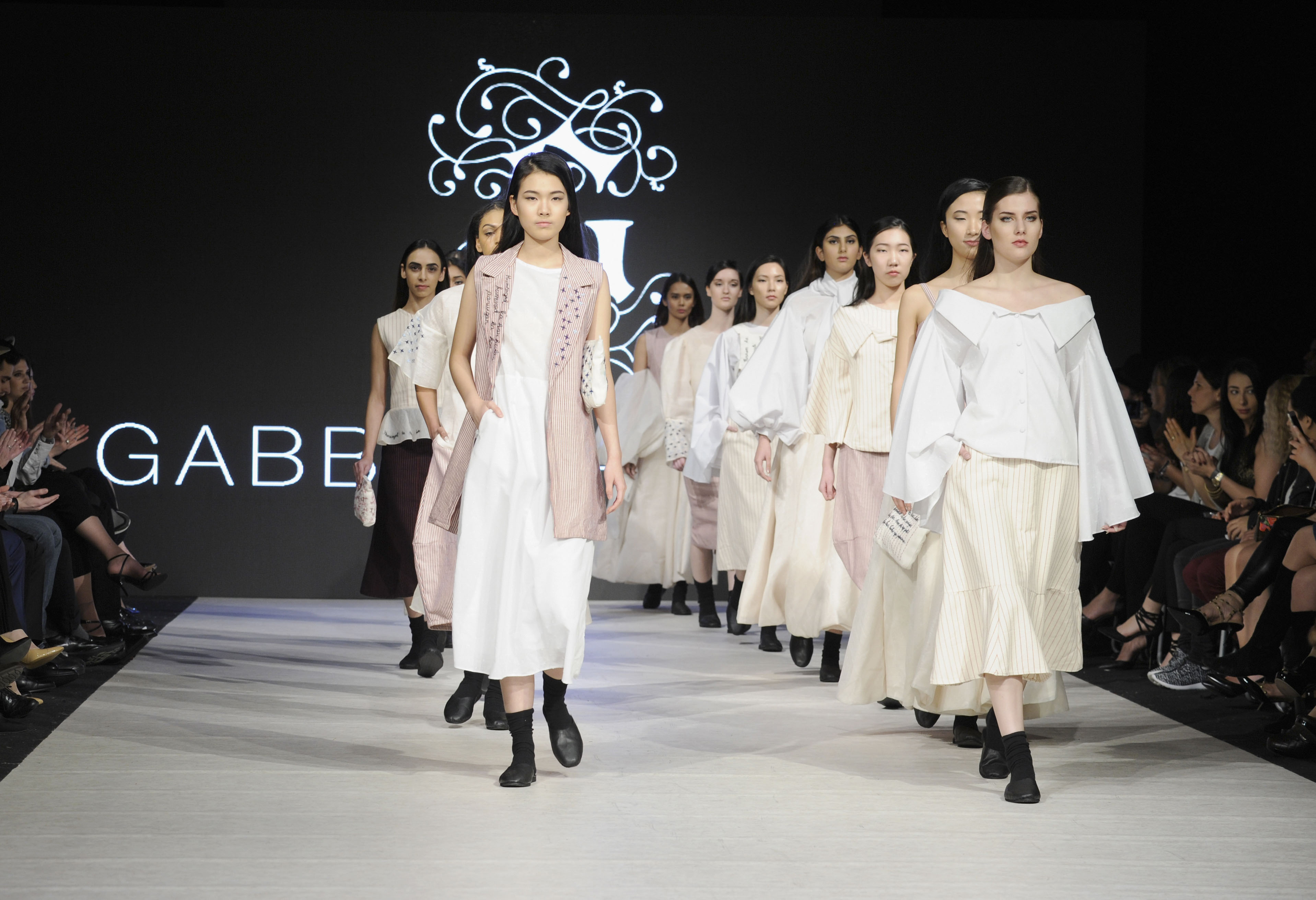 VANCOUVER, BC - MARCH 23:  Models walk the runway wearing Gabbie Sarenas at Vancouver Fashion Week Fall/Winter 2017 at Chinese Cultural Centre of Greater Vancouver on March 23, 2017 in Vancouver, Canada.  (Photo by Arun Nevader/WireImage)