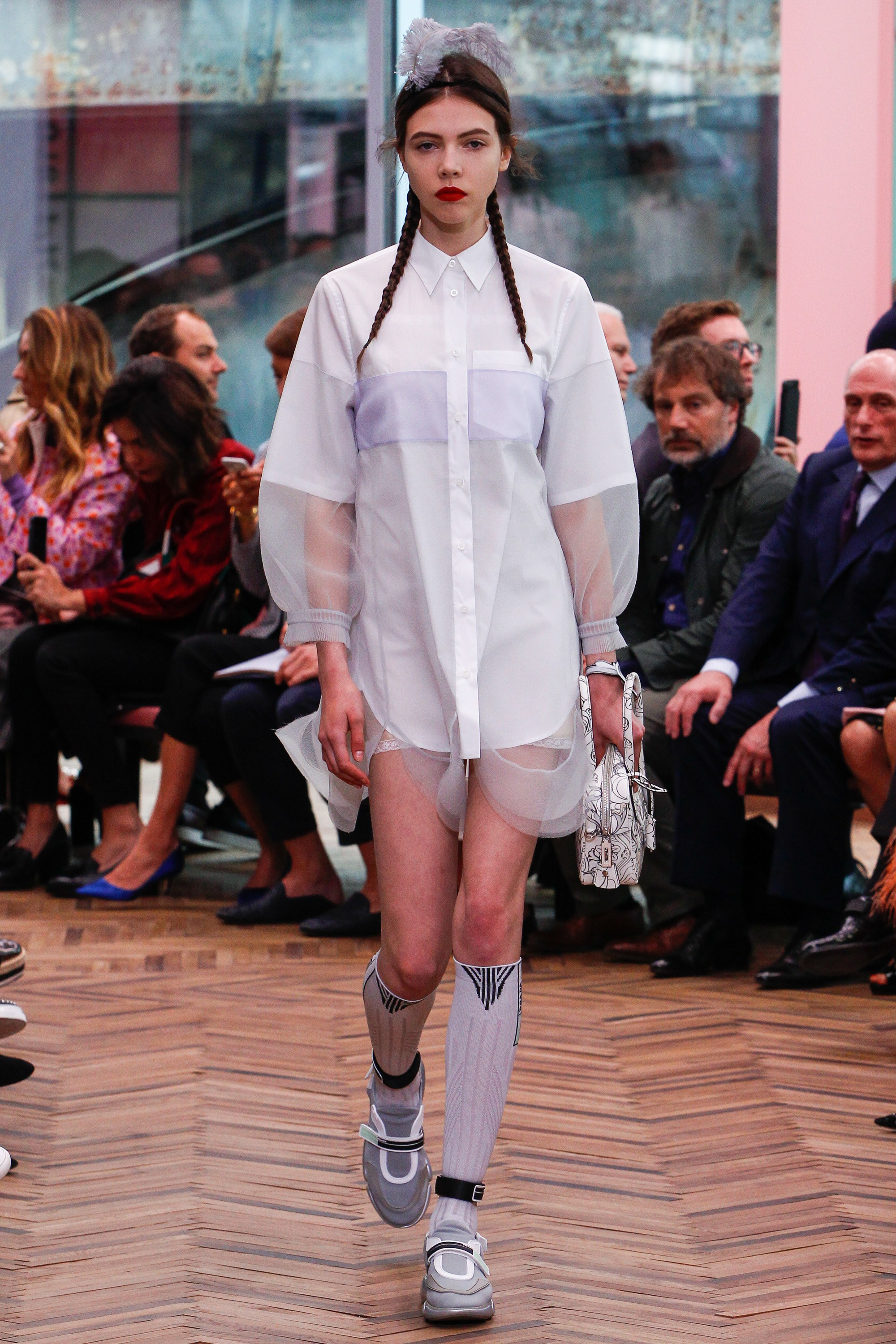 Prada is back on schedule with their Resort '18 Collection. Sending feminine dresses down the runway, alongside technical knits and other sporty references.