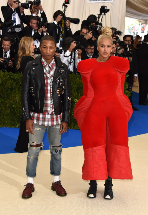 Pharrell Williams and Helen Lasichanh wearing Chanel and Comme des Garçons.