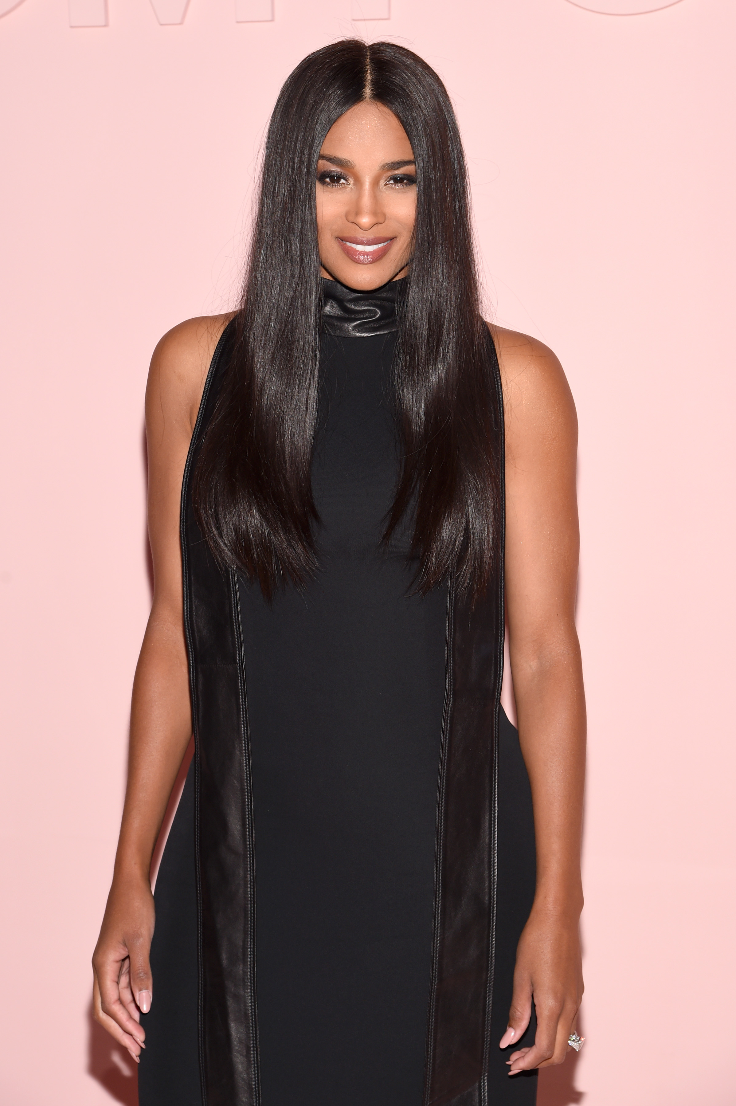 Ciara shows off svelte figure with a long body-hugging dress in her first red carpet appearance since giving birth to daughter, Sienna.