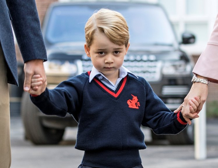 Prince George, son of Prince William and Kate Middleton, attends his first day of school at Thomas's Battersea in London on Thursday with his father by his side.