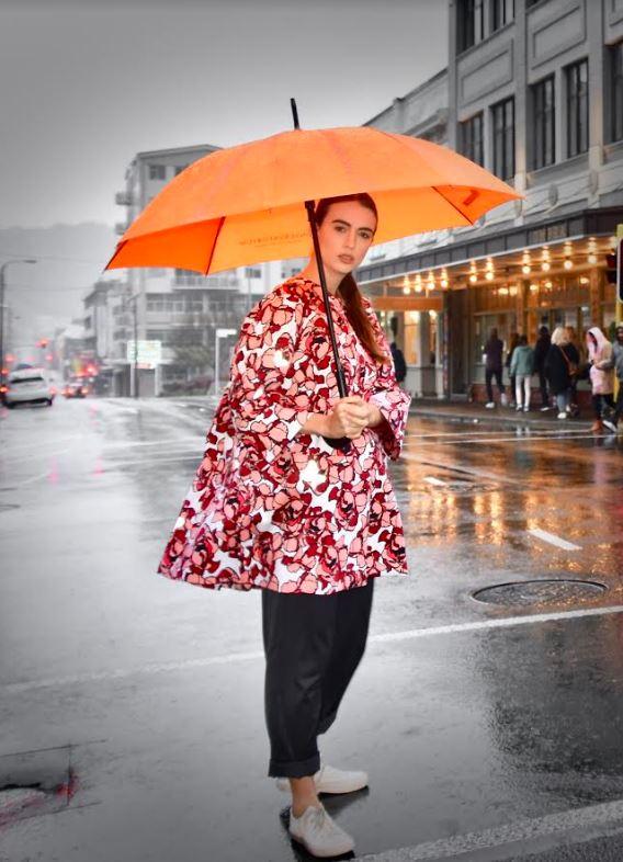 woman wears reflective lumen coat in wellington